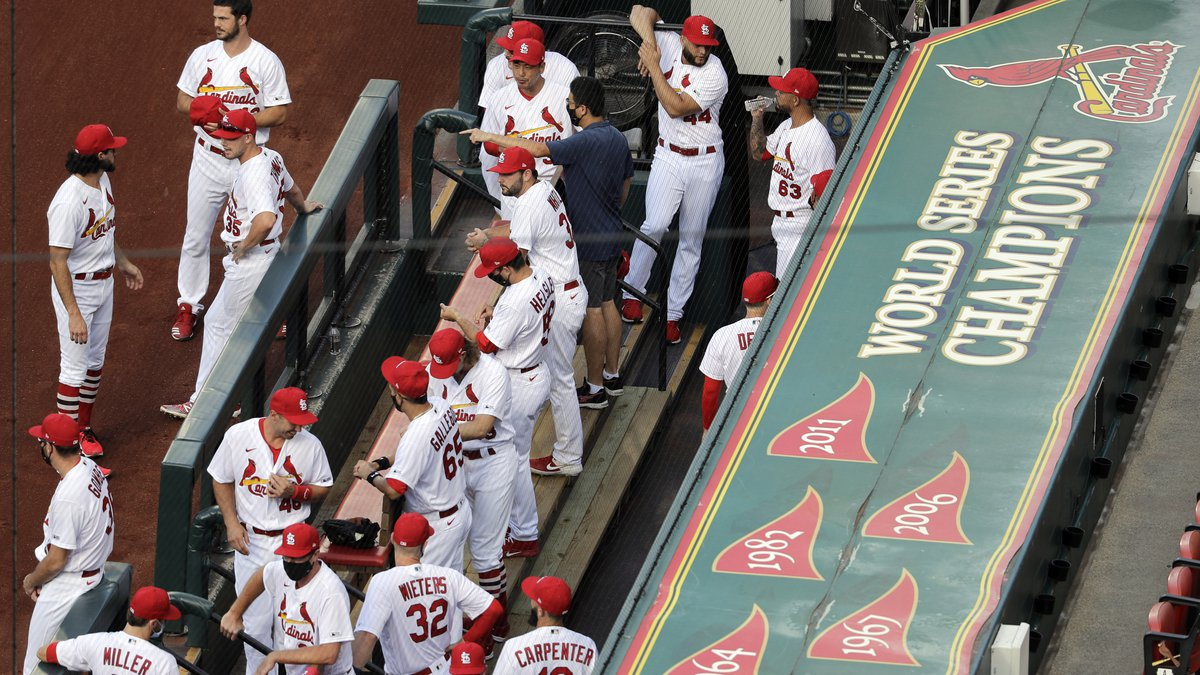 In this July 24, 2020, file photo, members of the St. Louis Cardinals wait to be introduced...