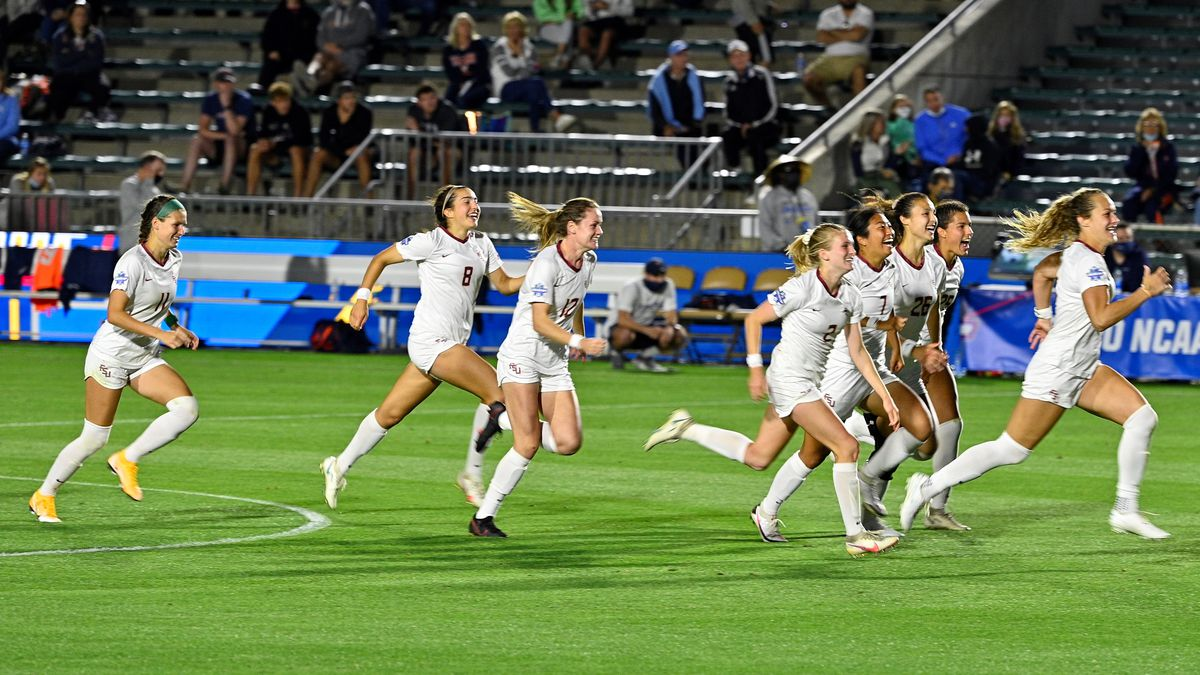 Florida State celebrates after defeating Virginia in penalty kicks to advance to the College...