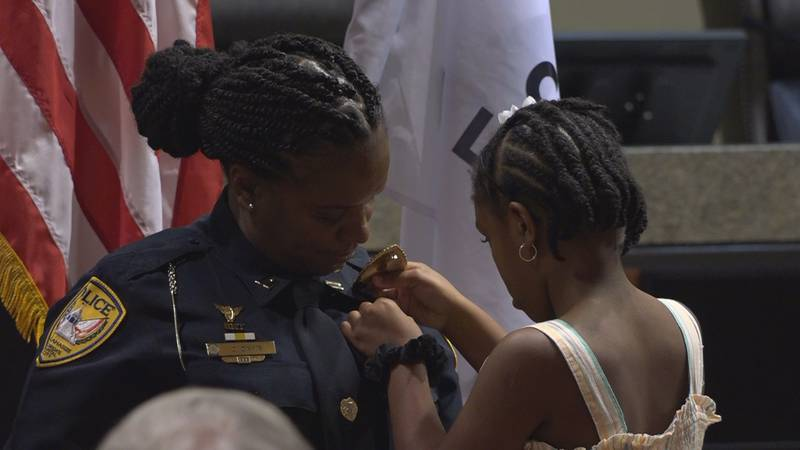The ceremony took place at City Hall; many family and friends were present, with children...