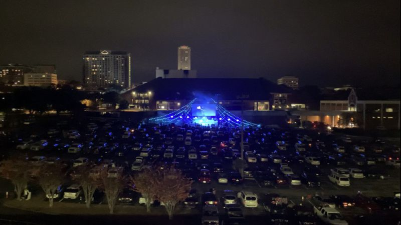 "Hundreds of cars were lined up to watch Christian pop band ""For King and Country"" perform in..."