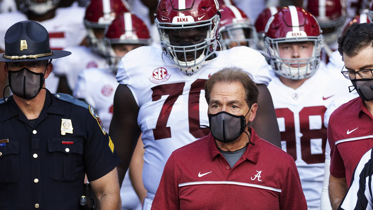 FILE - In this Sept. 26, 2020, file photo, Alabama coach Nick Saban leads his team to the field...