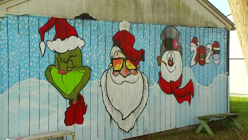 The artist says he hopes to make the neighborhood kids smile and give them a sense of self.