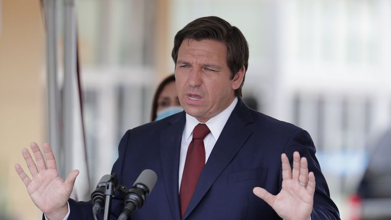 FILE - In this Thursday, May 14, 2020, file photo, Florida Gov. Ron DeSantis speaks at a news...