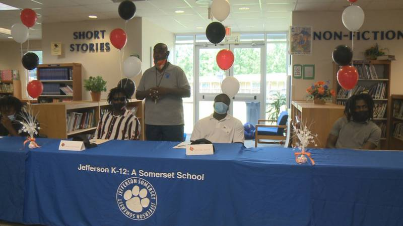 Friday afternoon, four Jefferson County Tigers signed football scholarships to the same school.