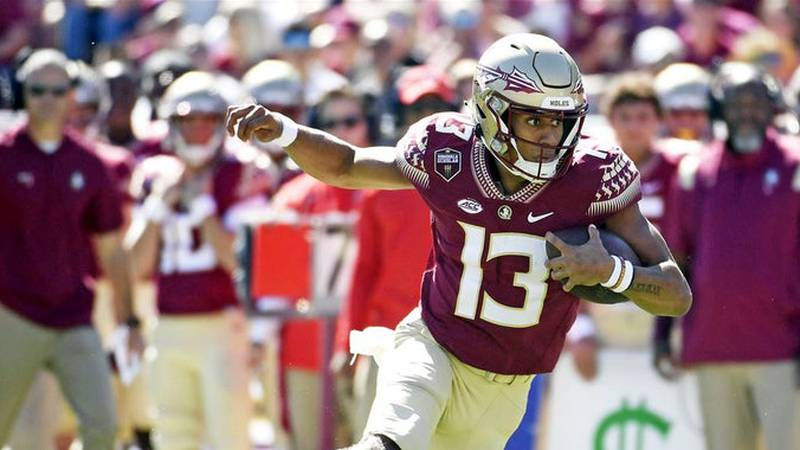 Jordan Travis threw for 123 yards and ran for 78 more in FSU's 59-3 win over UMass.