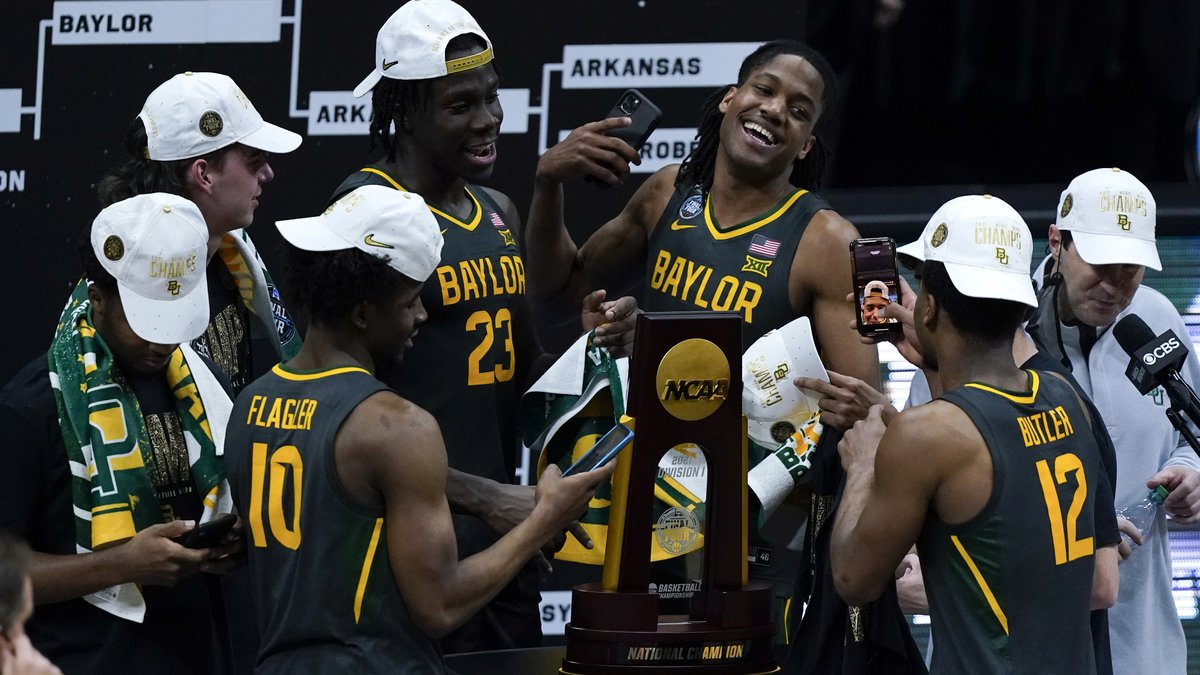Baylor players celebrate with the trophy at the end of the championship game against Gonzaga in...