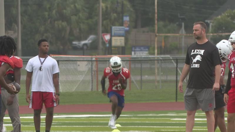 Every August, Coach Garrett Jahn and trainer Alan Morales take Leon High School's football team...