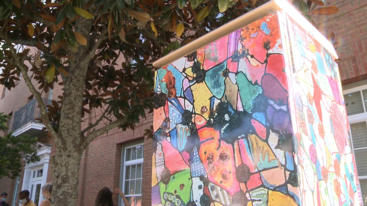 Local artist Christopher Barnhart had his artwork unveiled on Wednesday at the corner of Adams...