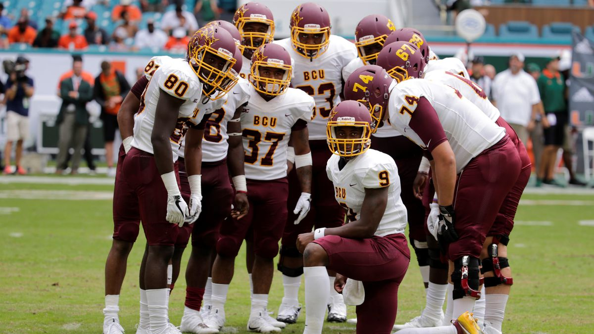 Bethune Cookman quarterback Jabari Dunham (9) talks in the huddle during the second half of an...