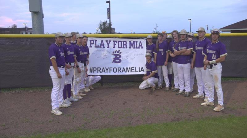 The Bainbridge HS baseball team gathers around a poster showing love for a player's sister...