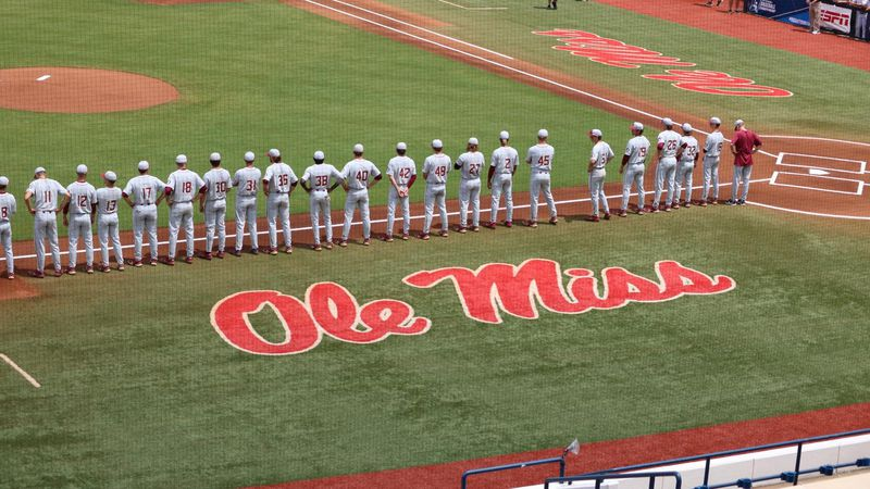 The FSU baseball team lines up down the third-base line before first pitch in the 2021 Oxford...