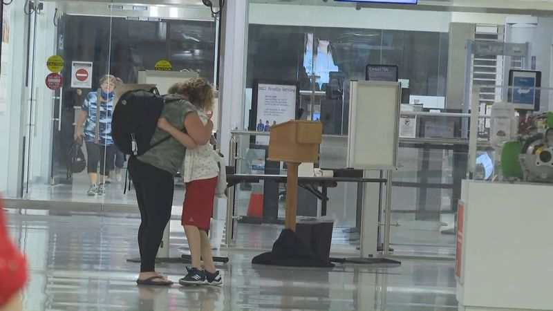 Lt. Commander Kate Lee hugs her son after return home to Tallahassee after spending 73 days in...
