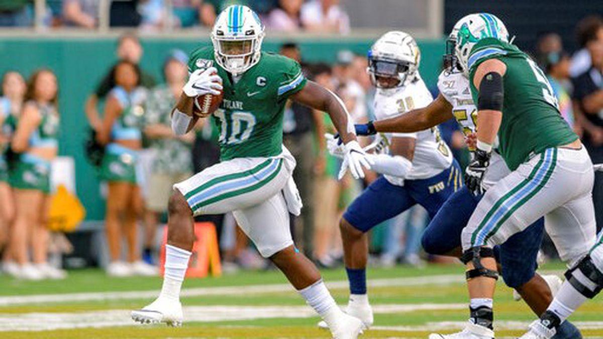 Tulane running back Darius Bradwell (10) runs against Florida International during an NCAA football game on Thursday, Aug. 29, 2019 in New Orleans. (AP Photo/Matthew Hinton)