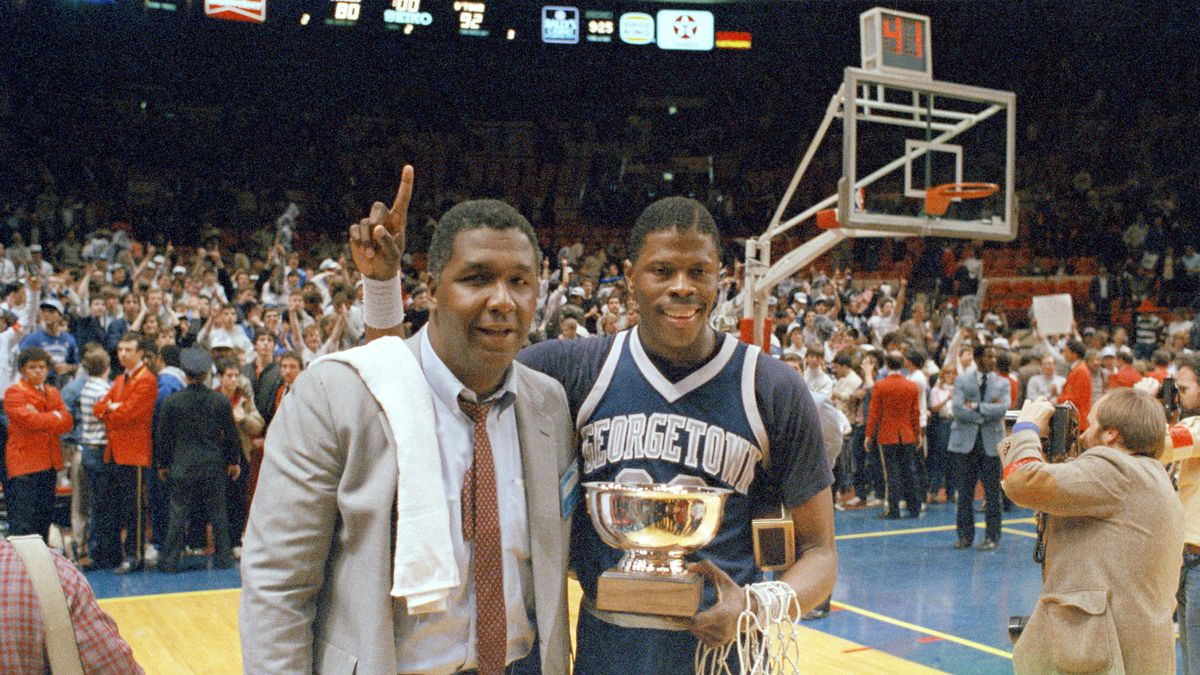 """FILE - In this March 9, 1985, file photo, Georgetown NCAA college basketball head coach John Thompson poses with player Patrick Ewing after Georgetown defeated St. John's in the Big East Championship in New York.  John Thompson, the imposing Hall of Famer who turned Georgetown into a """"Hoya Paranoia"""" powerhouse and became the first Black coach to lead a team to the NCAA men's basketball championship, has died. He was 78 His death was announced in a family statement Monday., Aug. 31, 2020. No details were disclosed."""