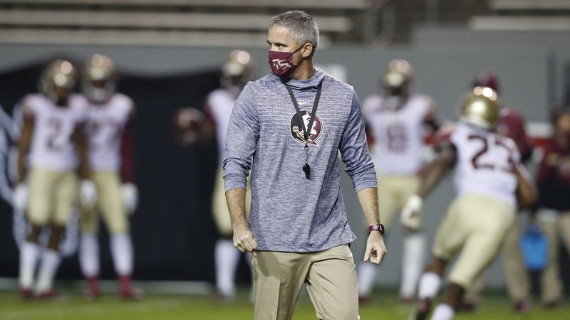Florida State head coach Mike Norvell watches his team warm up before N.C. State's game against...