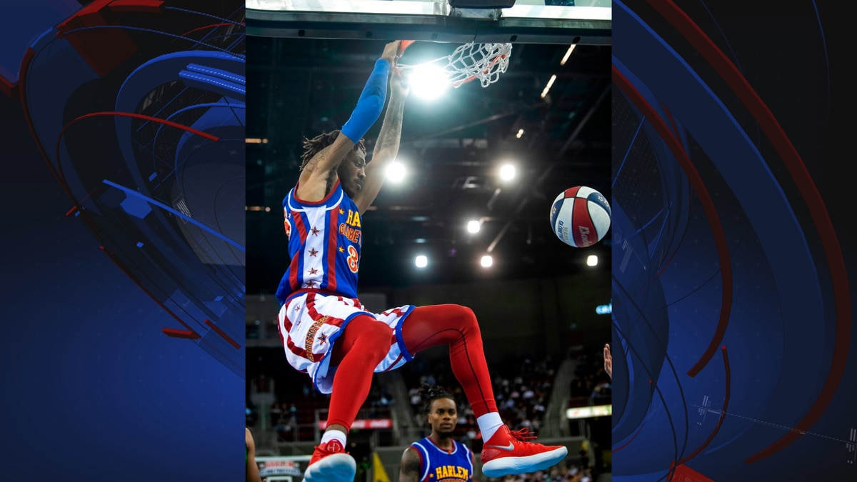 FILE: A member of the Harlem Globetrotters exhibition basketball team dunks against the...