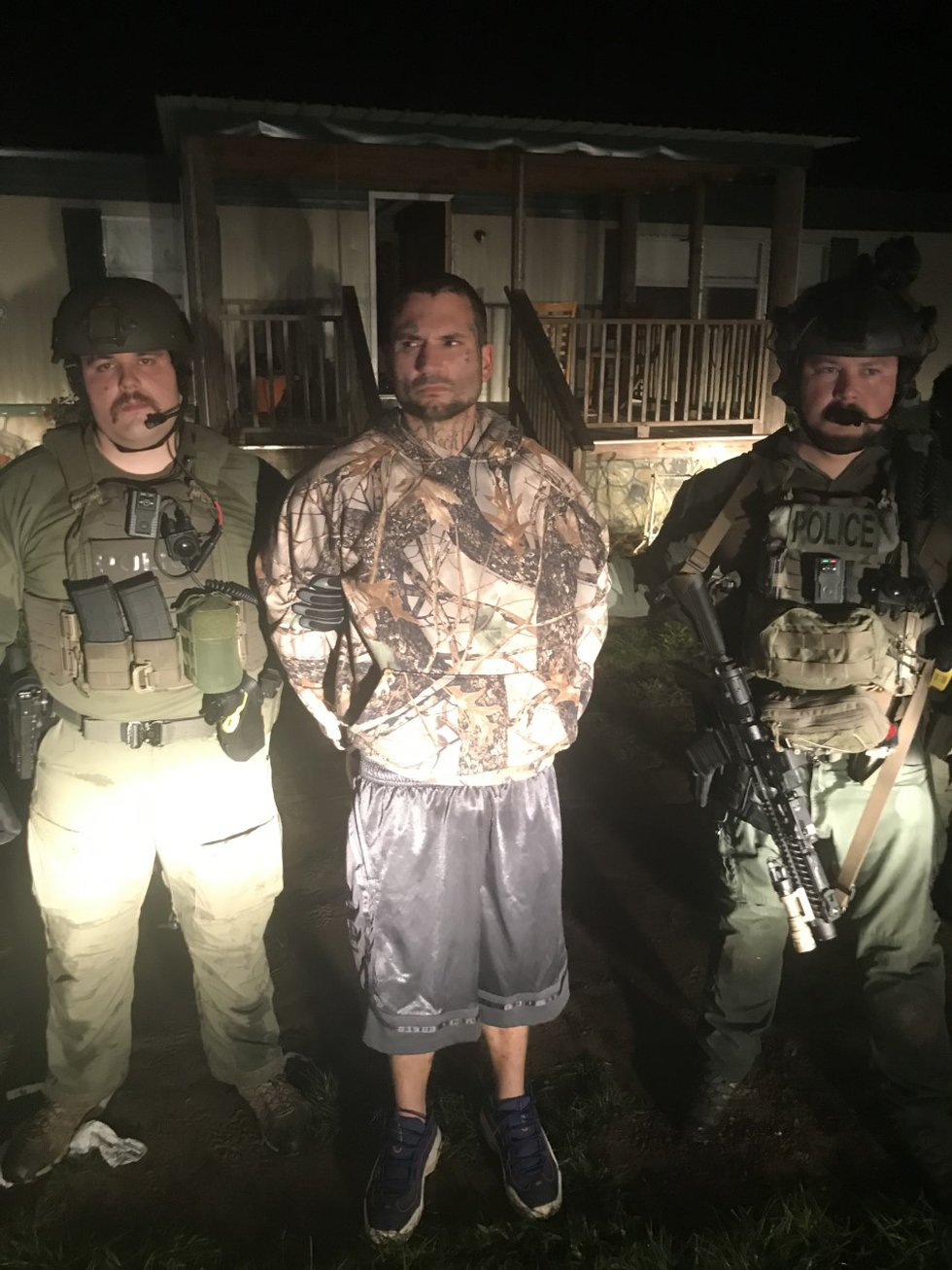 Skeeter Eugene Weeks being taken into custody after a standoff in Grady County on Thursday,...