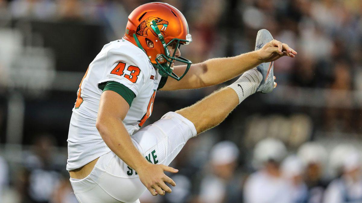 Florida A&M kicker Chris Faddoul (43) punts the ball during an NCAA football game against...