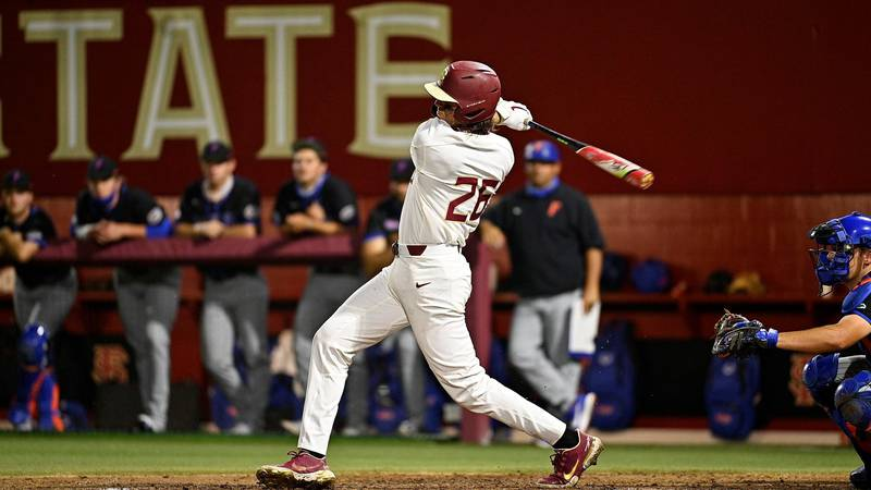 FSU's Robby Martin swings at a pitch against the Florida Gators.