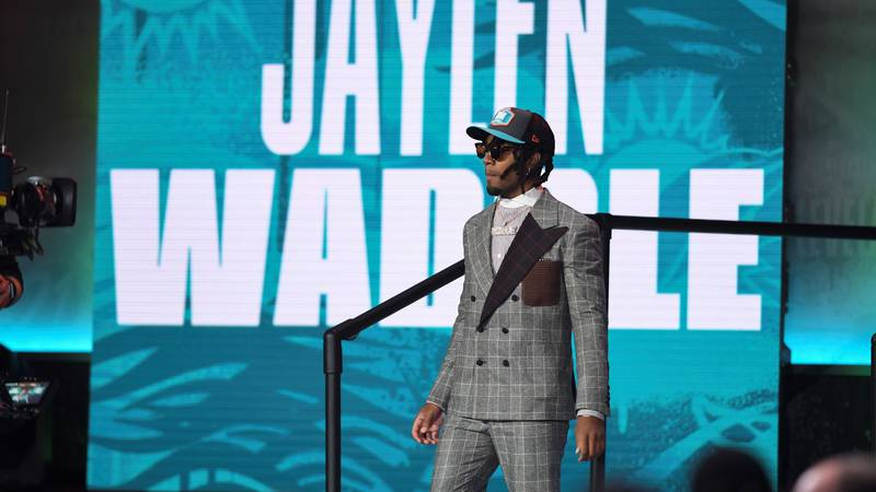 Alabama wide receiver Jaylen Waddle walks down the runway after being chosen by the Miami...