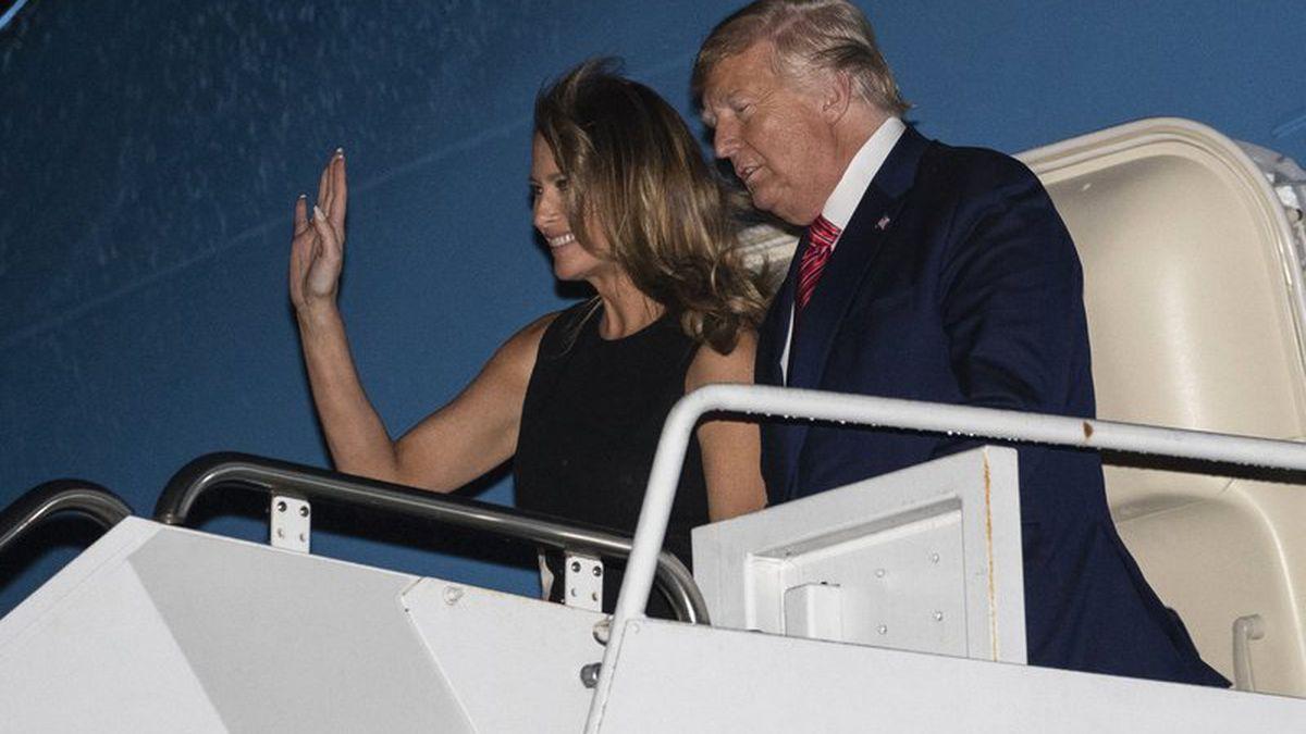 President Donald Trump, accompanied by first lady Melania Trump, steps off Air Force One at the Palm Beach International Airport, Friday, Feb. 14, 2020, in West Palm Beach, Fla. (AP Photo/Alex Brandon)