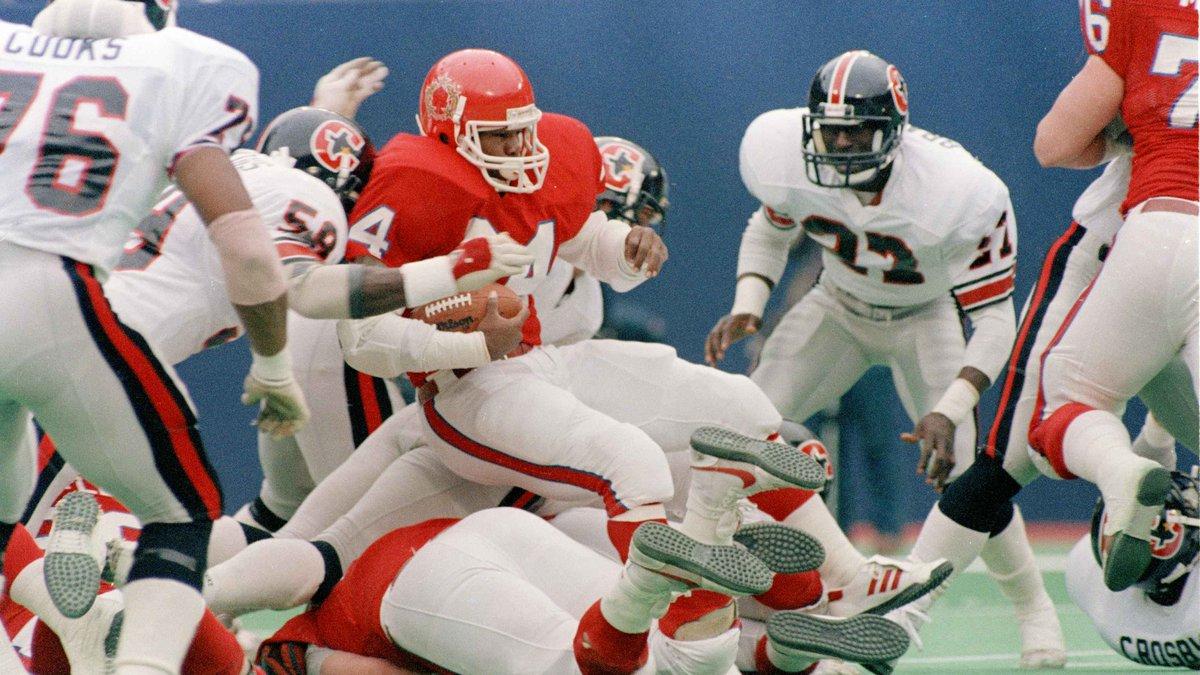 New Jersey Generals Herschel Walker is stopped by the Houston Gamblers defensive unit,...