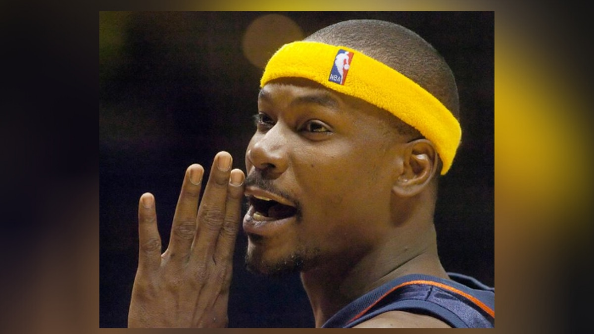 FILE - In this Nov. 15, 2004 file photo, Golden State Warriors' Clifford Robinson talks with fans during a foul shot in the fourth quarter against the Cleveland Cavaliers in Cleveland. Robinson, an early star on UConn's rise to power and longtime top sixth man in the NBA, has died. He was 53. Robinson's death was confirmed by UConn, Saturday, Aug. 29, 2020.