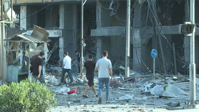 Buildings in Gaza are left with significant damage after Israeli airstrikes.