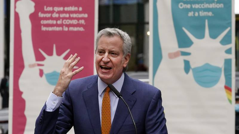 FILE - New York Mayor Bill de Blasio delivers remarks in Times Square after he toured the grand...