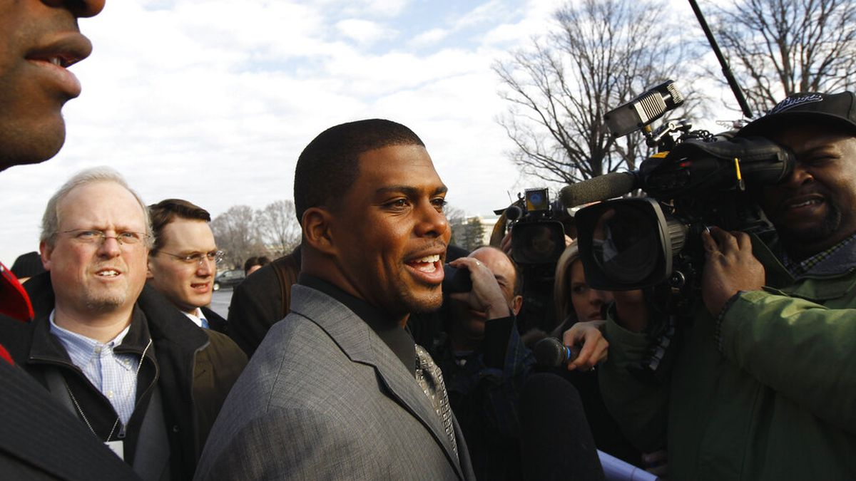 In this Jan. 19, 2011, file photo, Arizona Cardinals running back Jason Wright, center, talks to the media on Capitol Hill in Washington. The Washington Football Team has hired Wright as team president. He's the first Black person to hold this job in NFL history and at 38 becomes the youngest team president in the league.