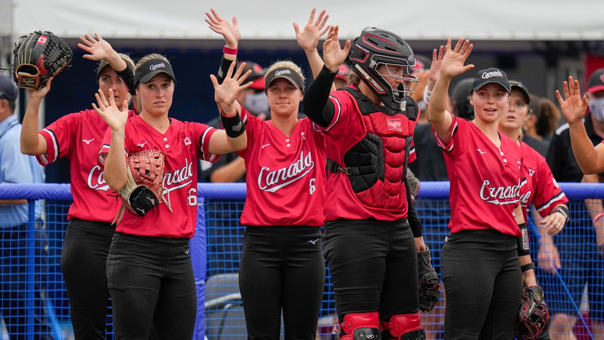 Canadian players wave following their 3-0 win over Mexico in their softball game at the 2020...