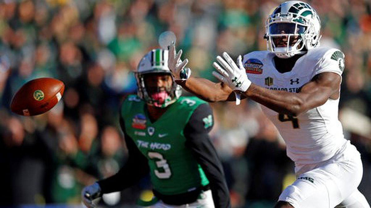 Colorado State wide receiver Michael Gallup (4) misses a reception as Marshall defensive back Chris Jackson (3) looks on during the first half of the New Mexico Bowl NCAA college football game in Albuquerque, N.M., Saturday, Dec. 16, 2017. (AP Photo/Andres Leighton)