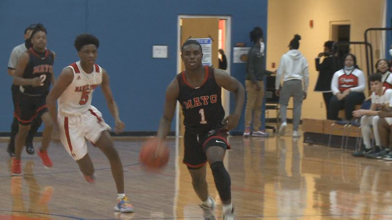 The Hamilton County Trojans defeated the Lafayette Hornets, 63-41, in district tournament...