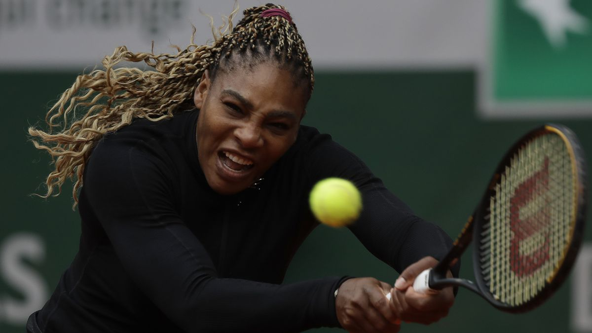 Serena Williams of the U.S. plays a shot against Kristie Ahn of the U.S. in the first round...
