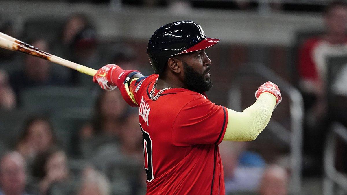 FILE - The Atlanta Braves' Marcell Ozuna follows through on a solo home run during the sixth...