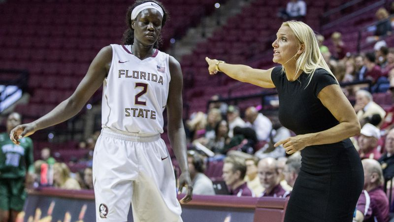 FSU assistant coach Brooke Wyckoff talks with Adut Bulgak on the court in the second half of an...