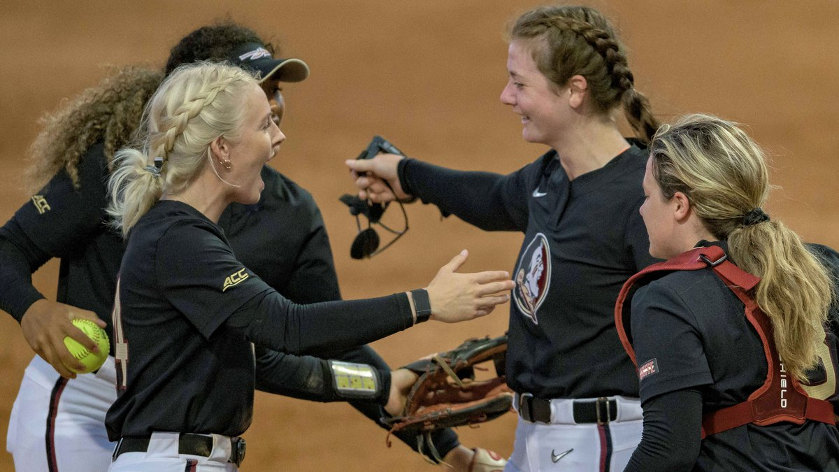Florida State pitcher Kathryn Sandercock (32), second right, is congratulated by Florida State...