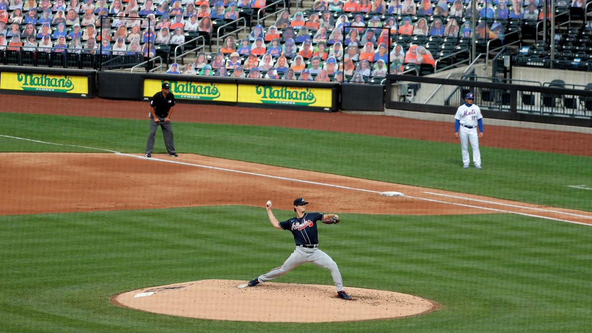 Atlanta Braves starting pitcher Mike Soroka, center, throws during the third inning of the baseball game against the New York Mets at Citi Field, Friday, July 24, 2020, in New York. (AP Photo/Seth Wenig)