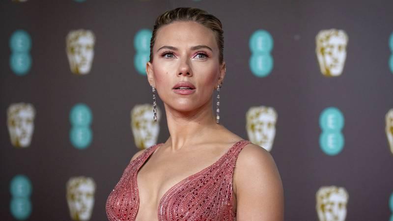 FILE - Scarlett Johansson arrives at the Bafta Film Awards, in central London, Feb. 2 2020....