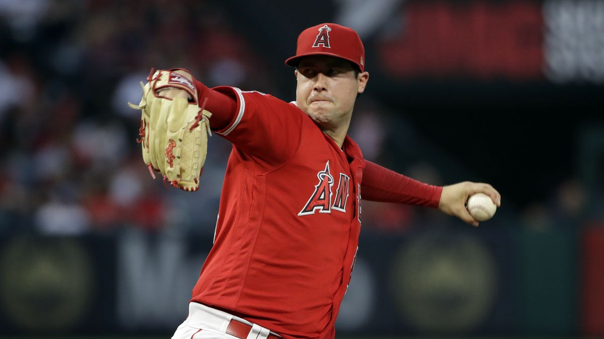 In this June 29, 2019, file photo, Los Angeles Angels starting pitcher Tyler Skaggs throws to the Oakland Athletics during a baseball game in Anaheim, Calif. Federal prosecutors say a former Angels employee has been charged with conspiracy to distribute fentanyl in connection with last year's overdose death of Angels pitcher Tyler Skaggs. Prosecutors in Texas say Eric Prescott Kay was arrested in Fort Worth, Texas, and made his first appearance Friday, Aug. 7, 2020, in federal court. Kay was communications director for the Angels.