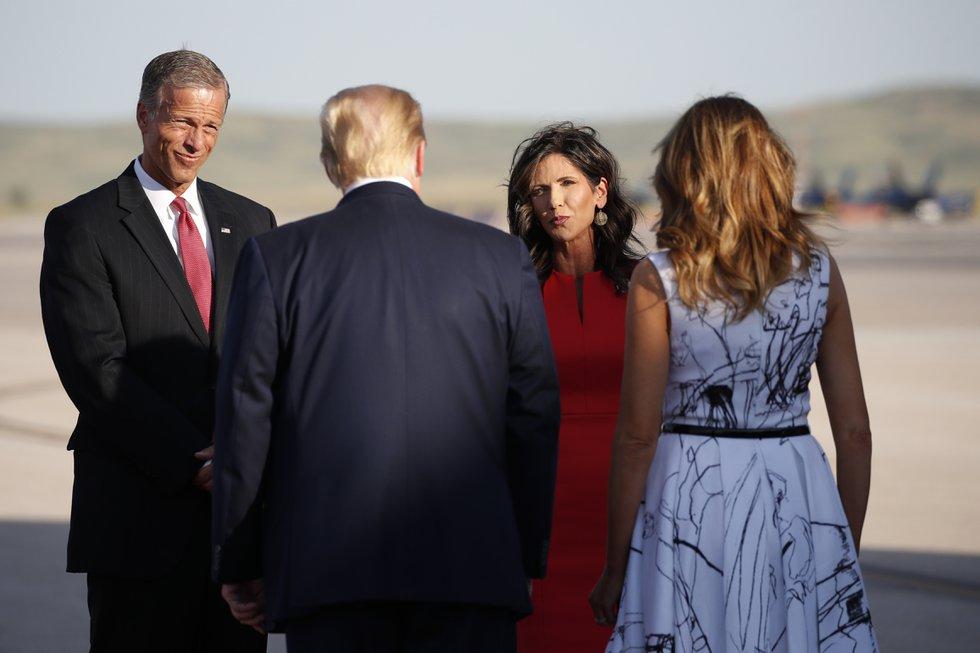 Sen. John Thune, R-S.D., and Gov. Kristi Noem greet President Donald Trump and first Lady...