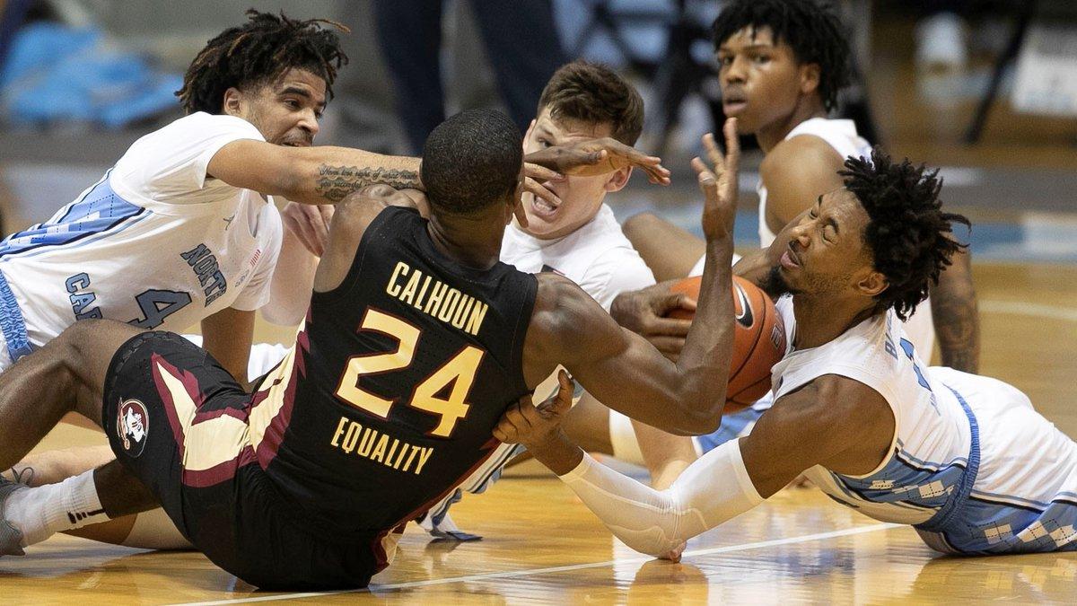 North Carolina's Leaky Black (1) battles for a loose ball with Florida State's Sardaar Calhoun...