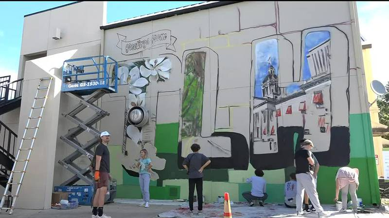 """A two-story mural in the Market District called """"Greetings from TLH"""" is almost complete."""