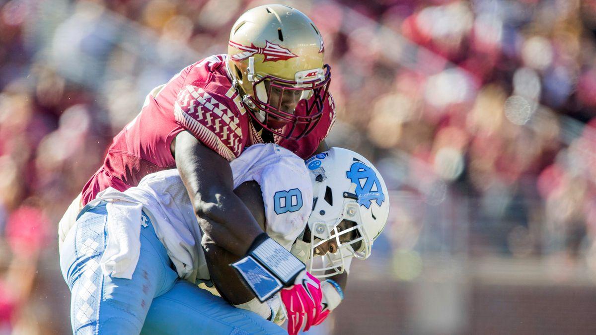 Florida State's linebacker Ro'Derrick Hoskins wraps up North Carolina running back T.J. Logan...