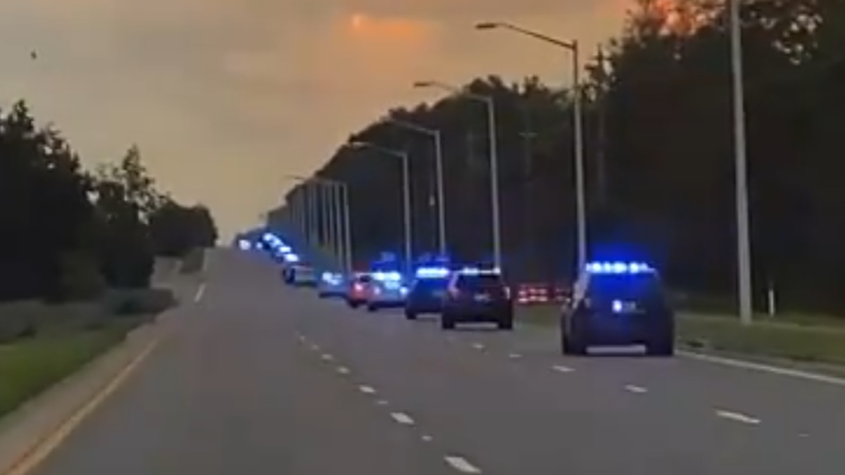 A line of TPD cars on Capital Circle Saturday, following the loss of one of their officers.