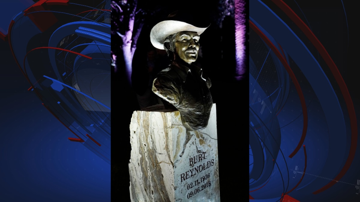 """A bronze bust of Burt Reynolds, with his famous mustache and sporting his """"Smokey and the..."""