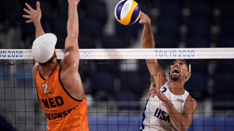 Robert Meeuwsen, of the Netherlands, blocks against Nicholas Lucena, of the United States,...