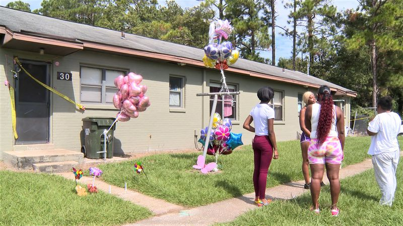 Alazia's mother, Tegina Brown, gathered outside her apartment Wednesday with close friends and...