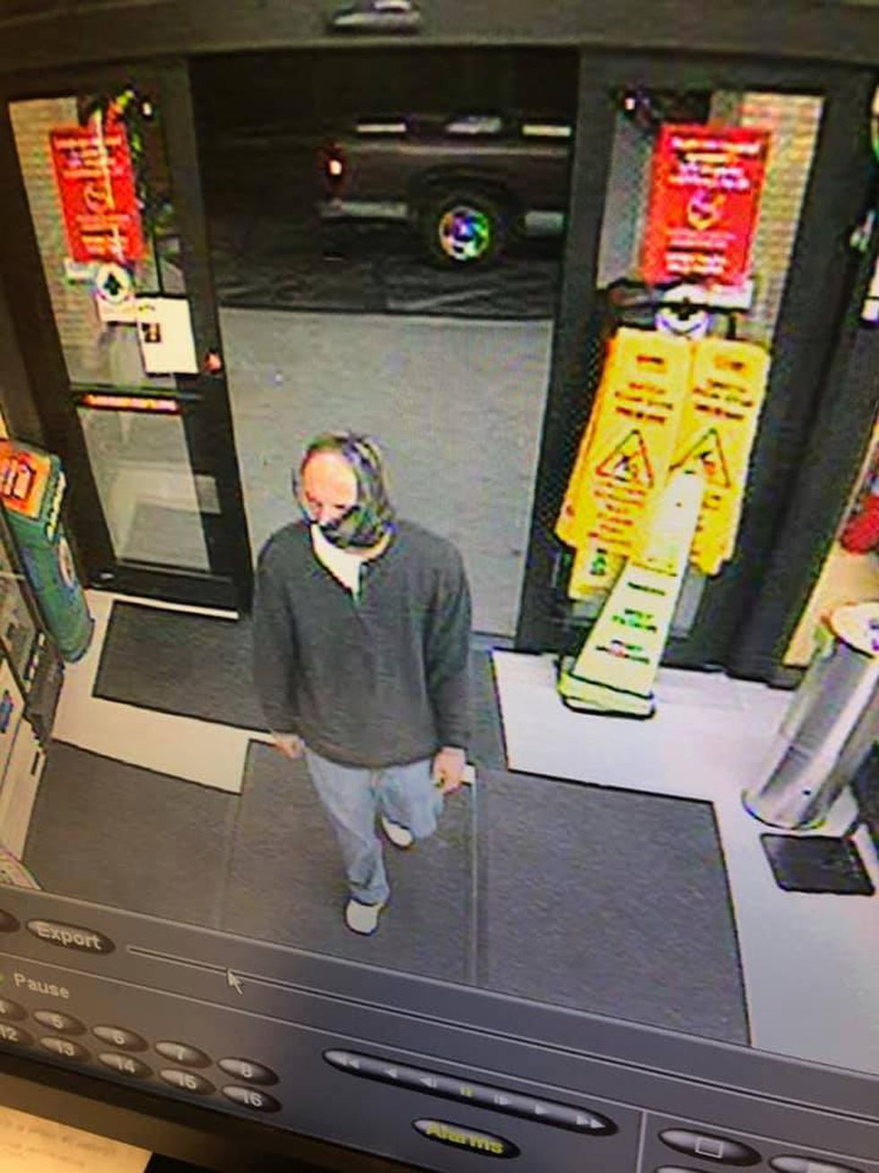 pon arrival at the store, deputies determined that a white man with a camouflage mask, gray...