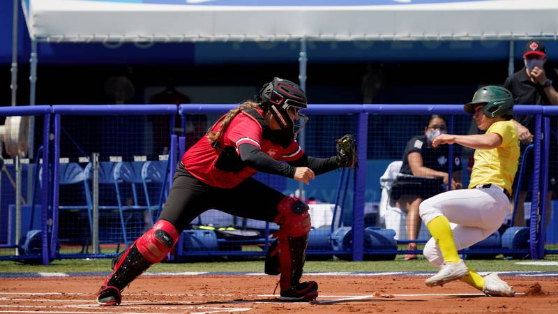 Canada catcher Kaleigh Rafter, right, forces out Australia's Leigh Godfrey, right, in the first...